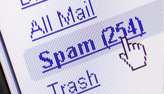 Imagem de caixa de spam em alusão ao denunciar spam
